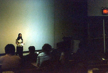 Suparak introducing a screening program at Pratt Institute.