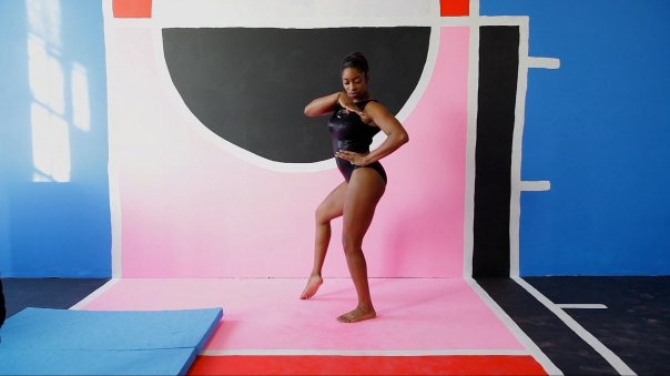 "Macon Reed, still from ""Gymnasts"", featuring Kim Randall, HD video, sound, 6 minutes, 2014."