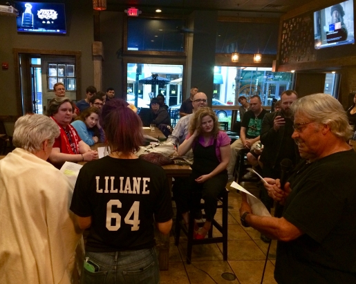 Audience at the SportsTalk poetry reading at a sports bar in Rockville, Maryland.