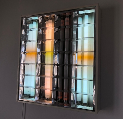 """""""UNTITLED (STILL NOT OVER YOU),"""" Iris Touliatou, 2018-ongoing. Ceiling light fixtures with dying fluorescent bulbs, foraged by the artist from abandoned offices and schools in Athens, Greece."""